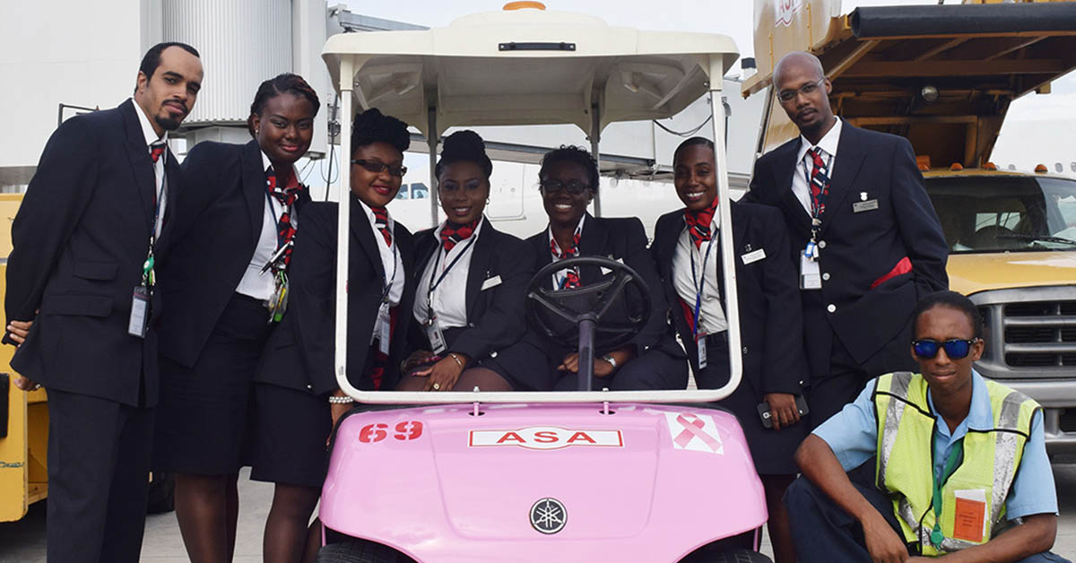 ASA team members on one of our golf carts